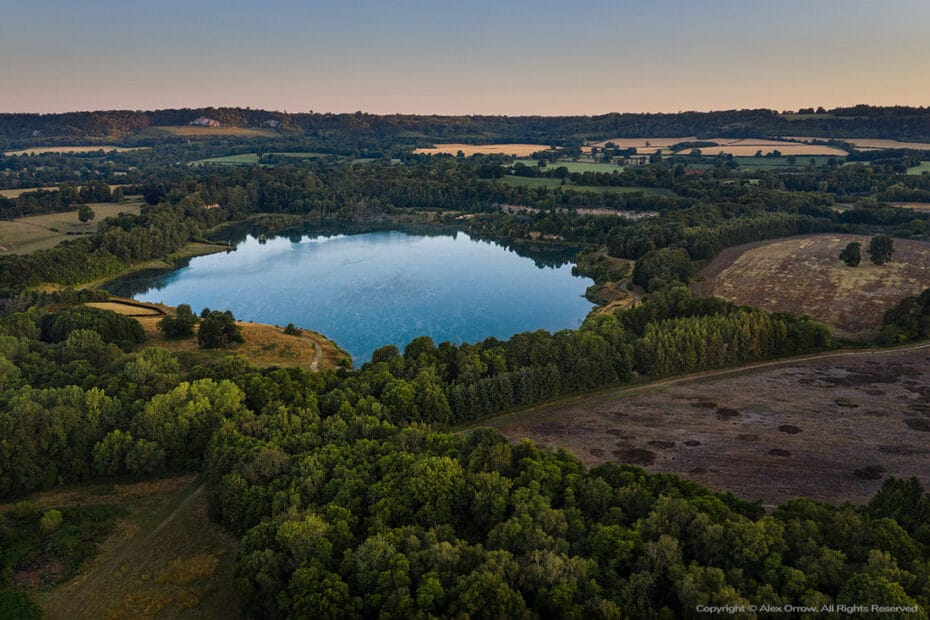 Drone aerial photograph over Surrey quarry lake