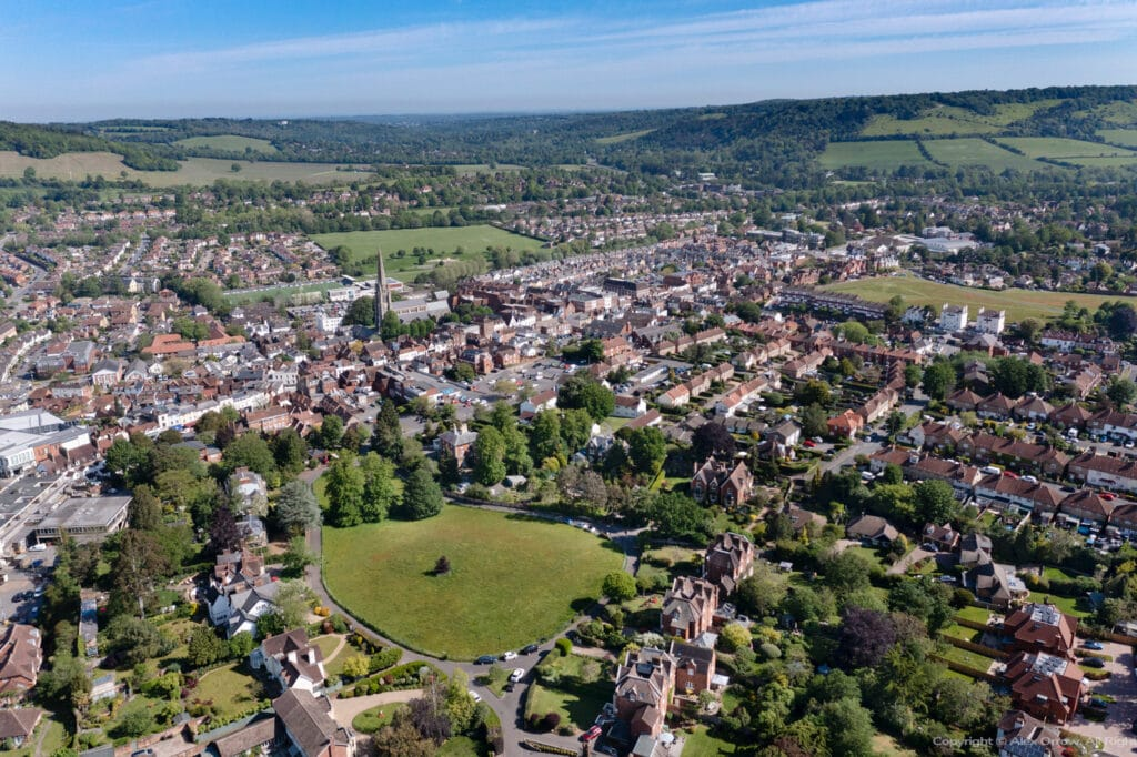 Aerial drone panorama view of Dorking Town Centre with Rose Hill Paddock St.Martins Church and Box Hill