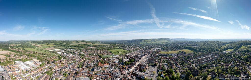 Aerial drone panorama view of Dorking Town Centre with St.Martins Church and Box Hill