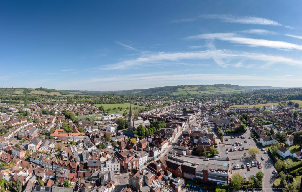 Aerial drone view of Dorking Town Centre with St.Martins Church and Box Hill
