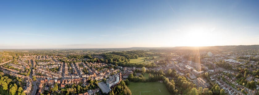 Panoramic Drone view of Reigate Town Centre and Priory Park during sunset.